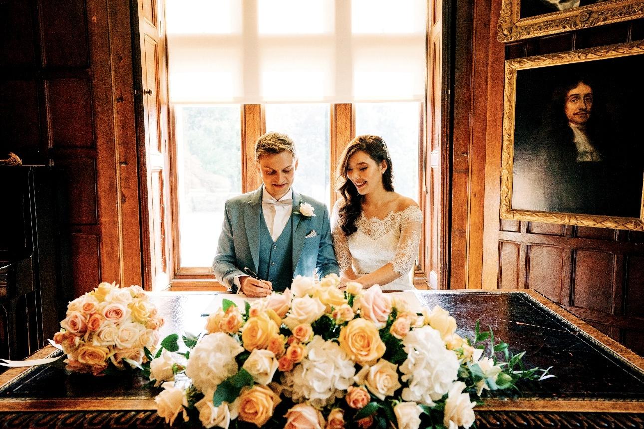 Newlyweds signing register