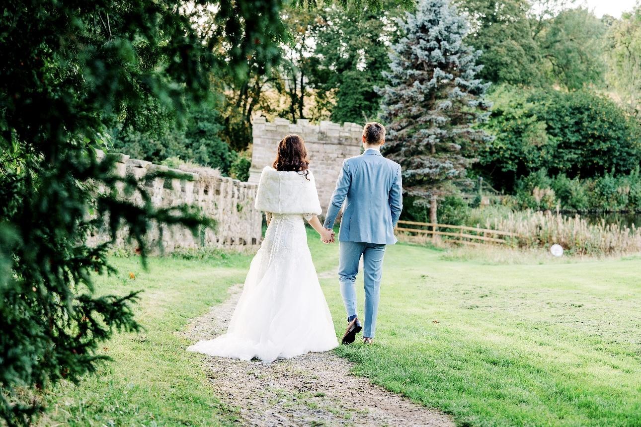 Couple walking through venue grounds