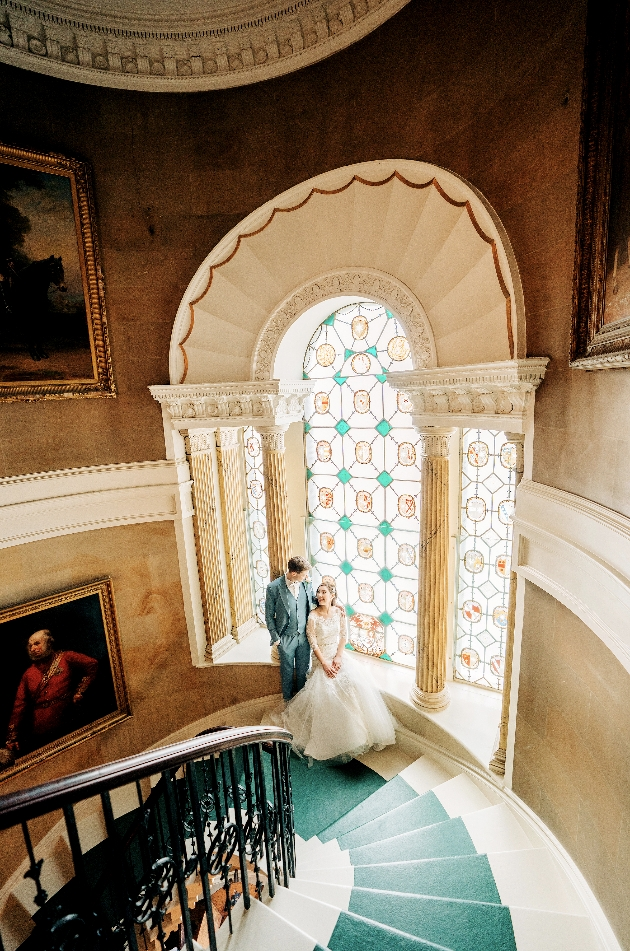 Couple on grand stairwell