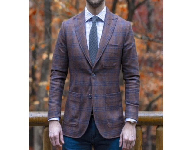 man in checked suite jacket and tie