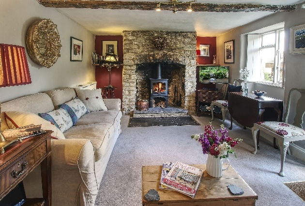 lounge of cottage vintage in style with wood burner