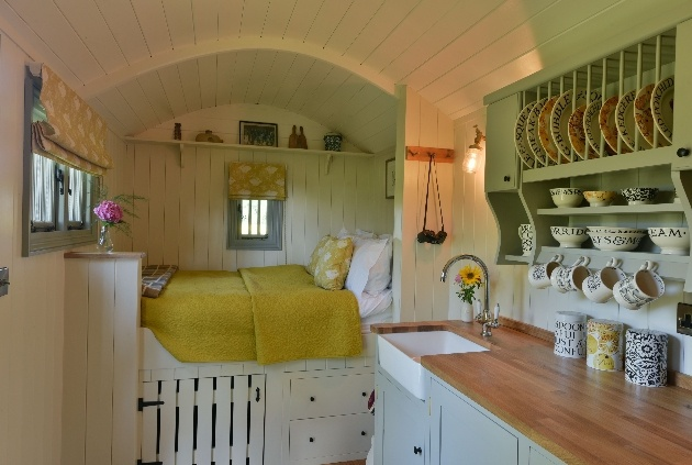 cabin bed white wood interior kitchen area