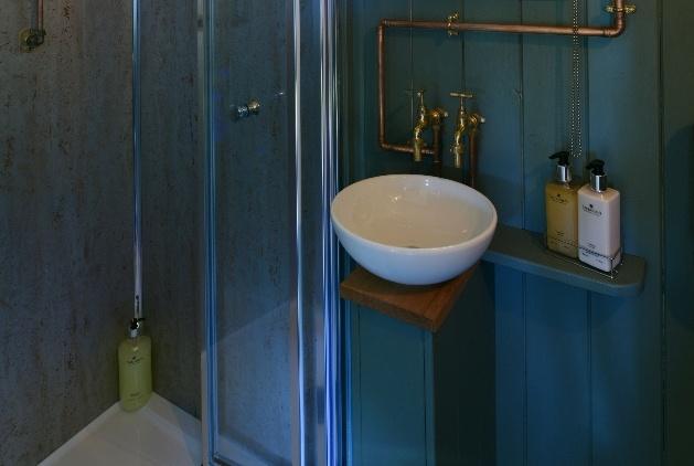 blue wood bathroom sink and shower