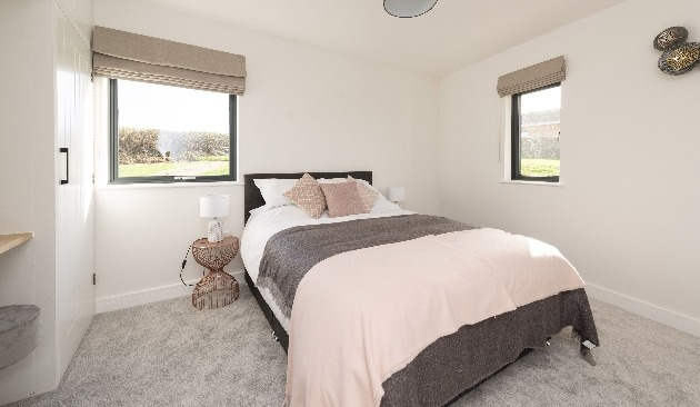 white and natural decor in bedroom with bed