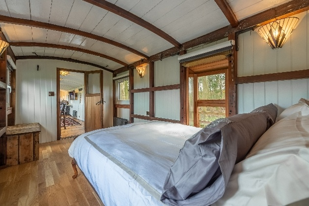 bedroom inside train white and wood detail