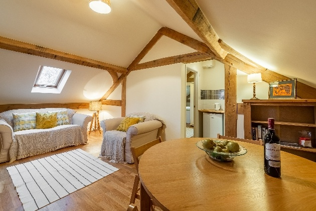 white and wood living space compact but cosy