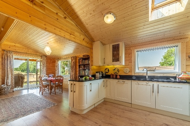 woodne chalet open plan kitchen with table