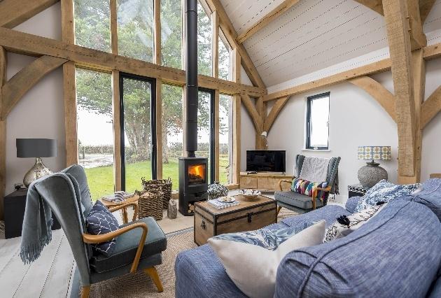 open plan loung high ceiling wood burner sofas
