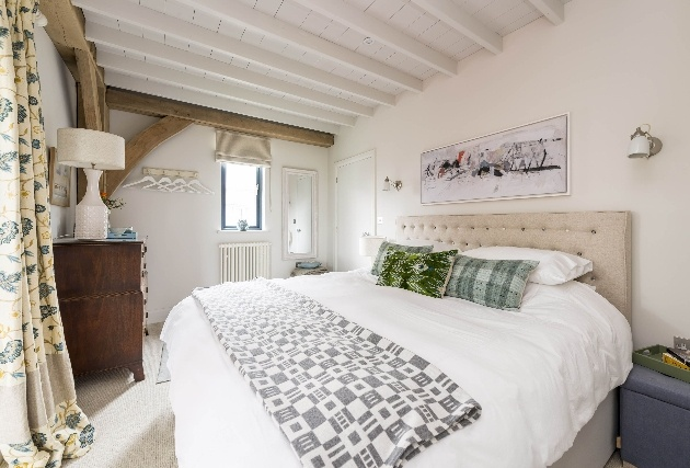 large bed in room with while decor