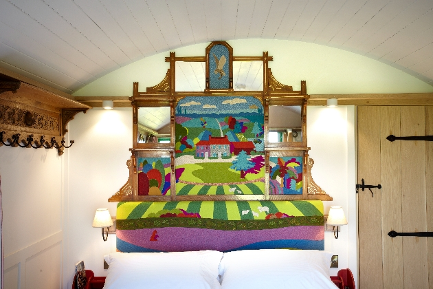 headboard with coloured folksy scene painted on