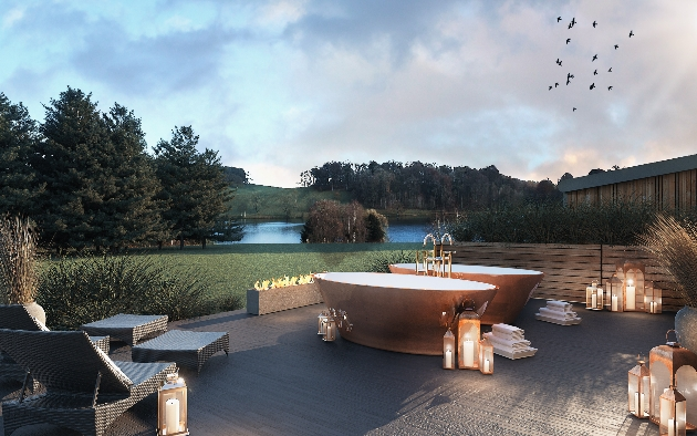 outdoor garden area with copper baths and candles lit at night