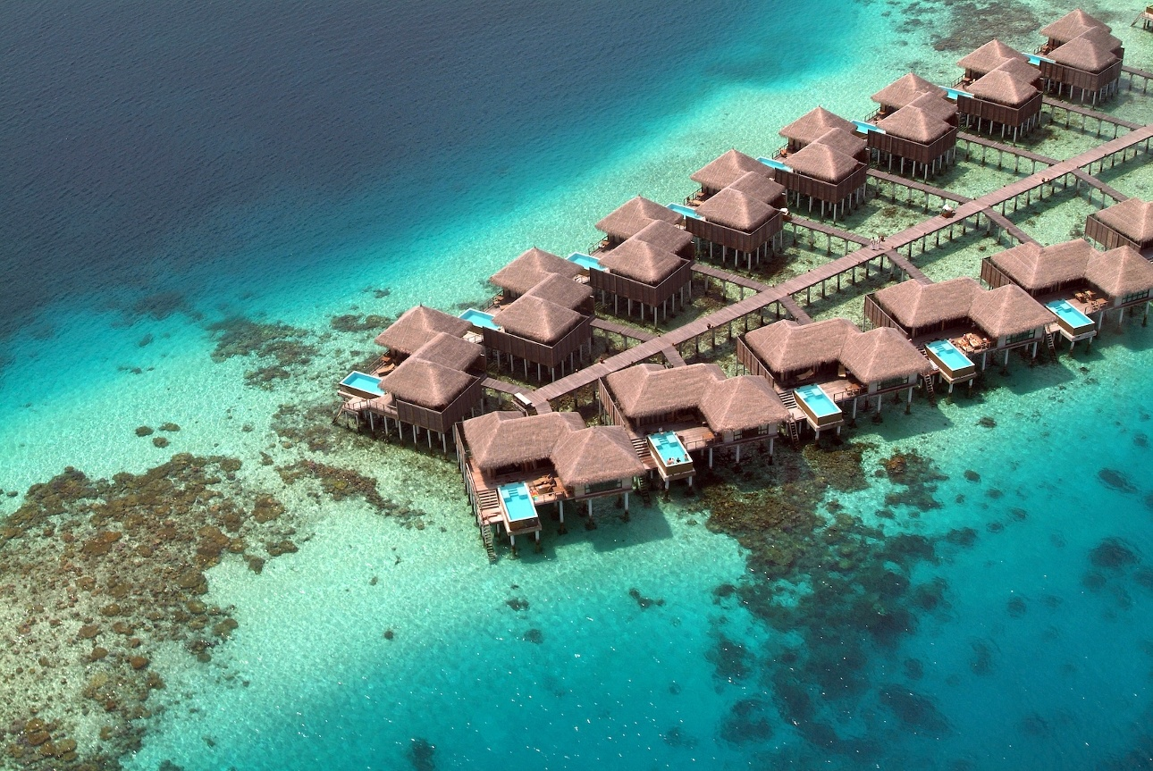 water bungalows in the ocean with pools